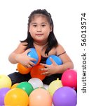happy asian cute girl playing with balloons - stock photo