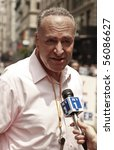 NEW YORK - JUNE 27: US Senator Charles Chuck Schumer gives interview at the 2010 New York City Gay Pride March on the streets of Manhattan on June 27, 2010 in New York City. - stock photo