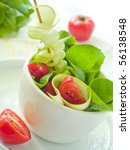 Salad from lettuce, tomatoes, zucchini with olive oil - stock photo