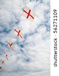 cross of st george bunting flags against a cloudy blue sky - stock photo