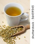 Cup of chamomile and flowers - stock photo