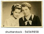 Vintage portrait of mother and daughter (twenties) - stock photo