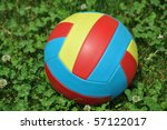 Closeup on colorful chlidren´s football in clover - stock photo