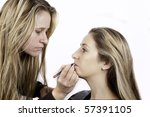 girls with long hair at hairdresser - stock photo