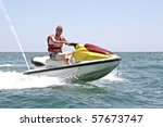 Young guy cruising on the atlantic ocean on a jet ski - stock photo