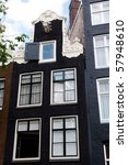 Richly decorated house fronts in Amsterdam, Netherlands - stock photo