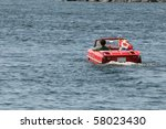 GRAVENHURST, ONTARIO, CANADA - JULY 10: Young couple driving a converted car into a boat during the annual Classic Boat Show July 10, 2010 in Gravenhurst,Ontario,Canada - stock photo