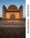 Morning sun brightens the western facade of Golgumbaz, a Mughal mausoleum in Bijapur, India. - stock photo