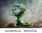 Still Life with Apple and flowers in vase - stock photo