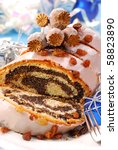 traditional sliced  poppy cake with icing and raisins for christmas - stock photo