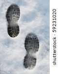 Footprints on the snow in wintertime - stock photo