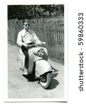 Vintage photo of young man on scooter (fifties/sixties) - stock photo