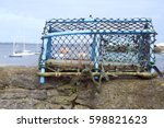 Lobster pot on a dock wall. Taken in Port St Mary in the Isle of Man - stock photo