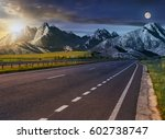 Day and night change Travel destination concept image. Composite landscape of High Tatra mountain ridge. Straight asphalt highway through green hills leads to high peaks. - stock photo