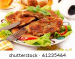 plate with breaded parasol mushrooms (kania) popular in Poland - stock photo