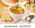 traditional polish tripe soup with vegetables in white elegance dishware - stock photo