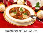 traditional polish clear mushroom soup with pearl barley for christmas in white elegance plate - stock photo