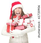 Christmas holidays shopping woman stress. Shopper holding christmas gifts stressed, frustrated and screaming angry. Funny image of Asian / caucasian woman in santa hat. Isolated on white background. - stock photo