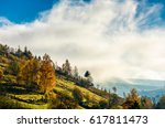 mountain rural area in autumn season. agricultural field in fog on a hill. beautiful and vivid countryside landscape. - stock photo