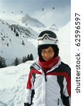 Portrait of young cute woman.Skier.Mountain background - stock photo