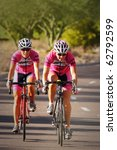 SCOTTSDALE, AZ - OCTOBER 2: Women cyclists compete in the Scottsdale Cycling Festival Criterium, a high-speed circuit race on a 1-kilometer closed course on October 2, 2010 in Scottsdale, AZ. - stock photo