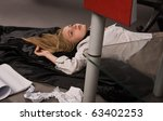 Srangled college girl lying on the floor - stock photo