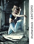 Young woman jumping on industrial background. - stock photo