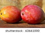 Two mangoes fruits. - stock photo