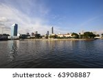 Singapore Skyline on a sunny day along the river! - stock photo
