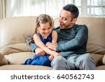 Little Girl And Father Are Enjoying Being Together At Home - stock photo