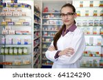 small business owner: portrait of a female pharmacist at pharmacy - stock photo