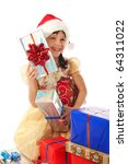 Smiling little girl with Christmas gift boxes - stock photo