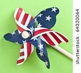 American Flag Patriotic Pinwheel on a Vibrant Green Background. - stock photo