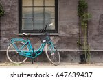 DENMARK, COPENHAGEN - MAY, 07, 2017: The lonely blue bicycle waiting for its owner - stock photo