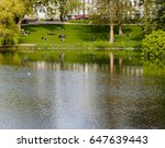 DENMARK, COPENHAGEN - MAY, 07, 2017: People lying on the grass in the park - stock photo