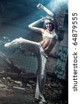 Young woman dancing on industrial background. Angle view. - stock photo