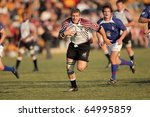 BLOEMFONTEIN, SOUTH AFRICA - AUGUST 7: Unidentified players during a rugby match between the North West (NWU) and Free State (UFS) Universities, on Aug 7, 2010 in Bloemfontein, South Africa. - stock photo