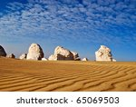 The limestone formation in White Desert and the waves of a golden sand - stock photo