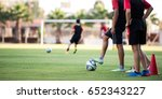 Young Football Players training On Green Field - stock photo