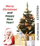 cheerful santa girl lie near the gift and New-year's tree. Copy text. Christmas greetings card - stock photo