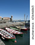 "Collioure, harbour with several boats and at the background the church called :""Eglise Notre Dame des Anges"" NO PEOPLE - stock photo"