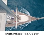 Top view of sailing boat with water splash - stock photo