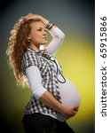 beautiful pregnant woman in the studio - stock photo