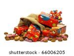 """colorful """"Sinterklaas""""presents in a burlap sack with some ginger nuts and candy on a white background - stock photo"""