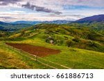wooden fence on hillside in the rural area in mountains. beautiful Carpathian countryside landscape. - stock photo