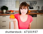 beautiful woman holding  orange - stock photo