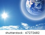Abstract background - earth in space with protective shield - stock photo