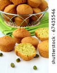 small cupcakes dessert with pistachios on a white table - stock photo