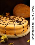Orange cake with cobwebs and pumpkins for Halloween - stock photo