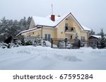 Beautiful house in snowy scenery of polish forest - stock photo